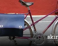 Two versions of a bike bag Skinclò in genuine leather