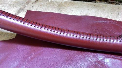 Skinclò-handcrafted-sailboat-wheels-genuine-leather-cover-handstiched